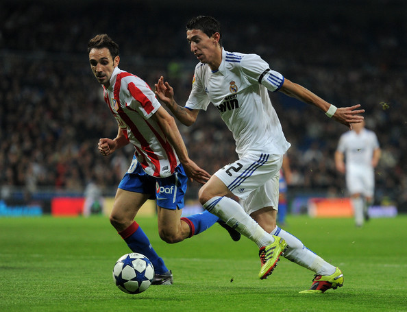 Angel Di Maria Angel Di Maria (R) of Real Madrid runs for the ball with Juan Francisco Torres of Atletico Madrid during the quarter-final Copa del Rey first leg match between Real Madrid and Atletico Madrid at Estadio Santiago Bernabeu on January 13, 2011 in Madrid, Spain.