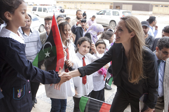 "Angelina Jolie (EDITORIAL USE ONLY)  In this handout photo privided by UNHCR, actress and U.N. Goodwill Ambassador Angelina Jolie visits Libya to help agencies bringing aid to Libyans in Tripoli and Misrata on October 11, 2011 in Misrata, Libya.  ""I have come to Libya for a variety of reasons, to see a country in transition at every level and to witness efforts to fully realise the promise of the Arab Spring,"" Jolie said.  ""The country faces a host of challenges, including internally displaced people, refugees, rule of law, security, sanitation, education, health and other humanitarian needs. All of these pieces must be delivered and coordinated properly in an environment of reconciliation and justice.""  The two-day trip was Jolie's first to Libya, but she previously visited Libyan refugees in Malta and on the Italian island of Lampedusa in June, and went to Tunisia in April to appeal for international support for people fleeing the revolution there.  Jolie is an ambassador for the United Nations refugee agency UNHCR and is expected to announce an expanded role soon.  On her Libya trip, she met representatives from UNHCR, Medecins Sans Frontieres and local non-governmental organisations delivering assistance to Libyans in Misrata and Tripoli.  (Photo by J Tanner/UNHCR via Getty Images)..(EDITORIAL USE ONLY) No commerical use. No Book Sales. Mandatory credit/byline. Not for sale for marketing or advertising campaigns. Image to be distributed exactly as supplied. No archive. Getty Images provides access to this publicly distributed image for editorial purposes and is not the copyright owner. Additional permissions may be required and are the sole responsibility of the end user."