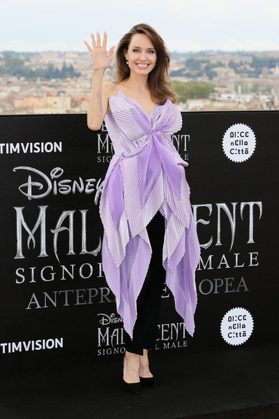 'Maleficent – Mistress Of Evil' Photocall [maleficent -- mistress of evil,clothing,purple,dress,fashion,footwear,advertising,magenta,style,fashion design,angelina jolie,photocall,photocall,italy,rome,hotel de la ville]