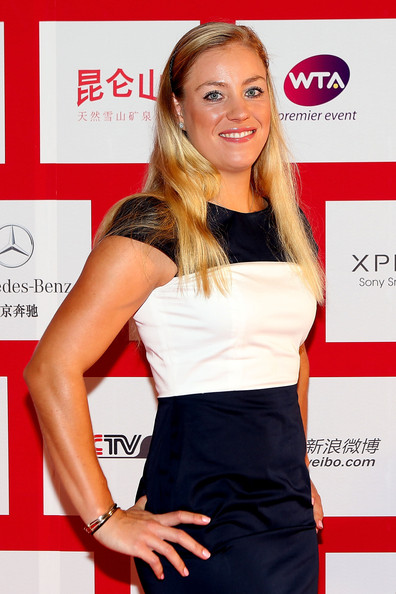 Angelique Kerber Angelique Kerber of Germany poses for photographers before the player party during the China Open at the Intercontinental Beijing Beichen hotel on October 1, 2012 in Beijing, China.