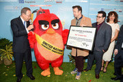 """(L-R) Mr. Ban Ki-Moon, 'Red', Jason Sudeikis, Josh Gad and Maya Rudolph attend the United Nations Ceremony, Presentation and Photo Call naming Red, from the """"ANGRY BIRDS"""" movie, Honorary Ambassador for the International Day of Happiness, to be observed around the world on March 20th, at United Nations on March 18, 2016 in New York City."""