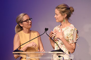 Animal Haven Director Tiffany Lacey  and Carolyn Murphy speak onstage during the Animal Haven Gala 2019 at Tribeca 360 on May 22, 2019 in New York City.