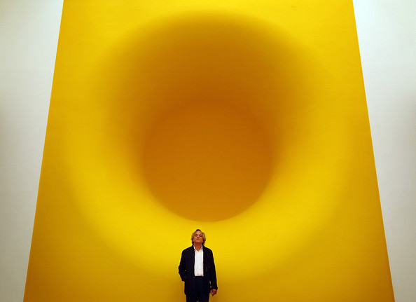 Anish Kapoor Anish Kapoor stands with his sculpture entitled  'Yellow' at The Royal Academy on September 22, 2009 in London. The Anish Kapoor exhibition runs from September 26 to December 11, 2009 at The Royal Academy.