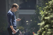 Mark Zuckerberg, chief executive officer of Facebook, checks his phone during the annual Allen & Company Sun Valley Conference, July 13, 2018 in Sun Valley, Idaho. Every July, some of the world's most wealthy and powerful businesspeople from the media, finance, technology and political spheres converge at the Sun Valley Resort for the exclusive weeklong conference.