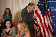"""Consumer advocate and former presidential candidate Ralph Nader arrives at the National Press Club's Newsmaker Luncheon September 4, 2014 in Washington, DC. From opposite ends of the political spectrum, Nader and founder and president of Americans for Tax Reform Grover Norquist talked about """"issues where the left and right can come together."""""""