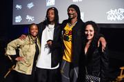 "Shante Broadus, Wiz Khalifa, Snoop Dogg and Constance Schwartz-Morini attend Apple Music - ""Wiz Khalifa: Behind The Cam"" Premiere on April 16, 2019 in Inglewood, California."