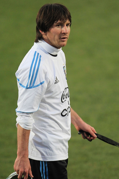 Lionel Messi of Argentina's national football team leaves the pitch during a team training session on June 20, 2010 in Pretoria, South Africa.