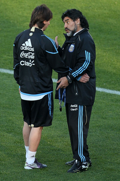 Argentina's head coach Diego Maradona talks with Lionel Messi during a team training session on June 6, 2010 in Pretoria, South Africa.
