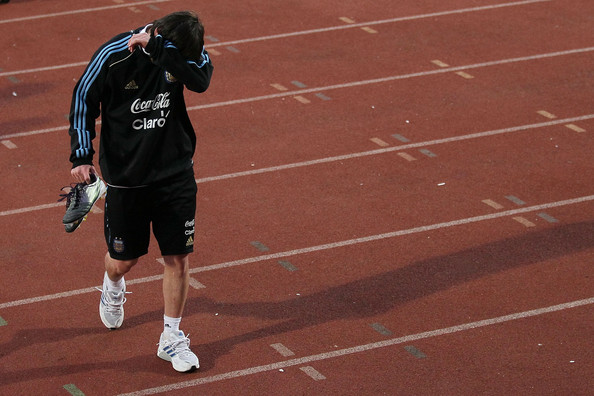 Lionel Messi of Argentina's national football team walks from the pitch during a team training session on June 10, 2010 in Pretoria, South Africa.