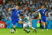 Muhamed Besic of Bosnia and Herzegovina challenges Maxi Rodriguez of Argentina during the 2014 FIFA World Cup Brazil Group F match between Argentina and Bosnia-Herzegovina at Maracana on June 15, 2014 in Rio de Janeiro, Brazil.