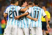(L-R) Sergio Aguero, Lionel Messi and Maxi Rodriguez of Argentina celebrate after their team's first goal during the 2014 FIFA World Cup Brazil Group F match between Argentina and Bosnia-Herzegovina at Maracana on June 15, 2014 in Rio de Janeiro, Brazil.