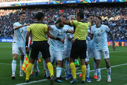 Players of Argentina argue with Referee Mario Diaz de Vivar after showing Lionel Messi of Argentina (not in frame) a red card during the Copa America Brazil 2019 Third Place match between Argentina and Chile at Arena Corinthians on July 06, 2019 in Sao Paulo, Brazil.