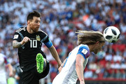 Lionel Messi of Argentina competes for the ball against Birkir Bjarnason of Iceland during the 2018 FIFA World Cup Russia group D match between Argentina and Iceland at Spartak Stadium on June 16, 2018 in Moscow, Russia.