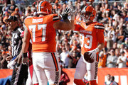 Brian Hartline #83 of the Cleveland Browns celebrates a second quarter touchdown with John Greco #77 while playing the Arizona Cardinals at FirstEnergy Stadium on November 1, 2015 in Cleveland, Ohio.