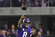 Kirk Cousins #8 of the Minnesota Vikings passes the ball in the first quarter of the game agains the Arizona Cardinals at U.S. Bank Stadium on October 14, 2018 in Minneapolis, Minnesota.