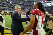 Minnesota Vikings owner Zygi Wilf greets Larry Fitzgerald #11 of the Arizona Cardinals after the game at U.S. Bank Stadium on October 14, 2018 in Minneapolis, Minnesota. The Vikings defeated the Cardinals 27-17.