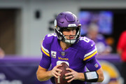 Kirk Cousins #8 of the Minnesota Vikings warms up on field before the game against the Arizona Cardinals at U.S. Bank Stadium on October 14, 2018 in Minneapolis, Minnesota.