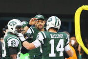 Greg McElroy #14 of the New York Jets celebrates with   Mark Sanchez #6  after throwing his first touchdown in the NFL to  Jeff Cumberland #86 against the Arizona Cardinals during their game at at MetLife Stadium on December 2, 2012 in East Rutherford, New Jersey. The Jets won 7-6.