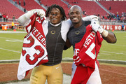 Adrian Peterson #23 of the Arizona Cardinals and Reuben Foster #56 of the San Francisco 49ers trade jerseys after their NFL game at Levi's Stadium on November 5, 2017 in Santa Clara, California.