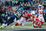 Running back Elijhaa Penny #35 of the Arizona Cardinals scores a 4 yard touchdown against free safety Earl Thomas #29 of the Seattle Seahawks in the second quarter at CenturyLink Field on December 31, 2017 in Seattle, Washington.