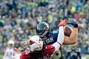 Tight end Jimmy Graham #88 of the Seattle Seahawks almost makes a catch against the Arizona Cardinals at CenturyLink Field on December 24, 2016 in Seattle, Washington.