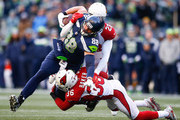 Tight end Jimmy Graham #88 of the Seattle Seahawks makes a 20 yard reception on 4th down against safety Budda Baker of the Arizona Cardinals and Justin Bethel #28 at CenturyLink Field on December 31, 2017 in Seattle, Washington.