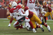 Quarterback Blaine Gabbert #7 of the Arizona Cardinals is sacked by offensive tackle Kevin Bowen #72 of the Washington Redskins in the first quarter at FedEx Field on December 17, 2017 in Landover, Maryland.