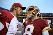 Quarterback Blaine Gabbert #7 of the Arizona Cardinals and quarterback Kirk Cousins #8 of the Washington Redskins talk after the Washington Redskins 20-15 win over the Arizona Cardinals at FedEx Field on December 17, 2017 in Landover, Maryland.