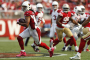 Larry Fitzgerald #11 of the Arizona Cardinals runs with the ball after a catch against the San Francisco 49ers during their NFL game at Levi's Stadium on October 7, 2018 in Santa Clara, California.