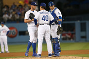 Starting pitcher Chris Capuano #35 of the Los Angeles Dodgers meets with pitching coach Rick Honeycutt #40 and catcher A.J. Ellis #17 in the second inning against the Arizona Diamondbacks at Dodger Stadium on May 6, 2013 in Los Angeles, California.
