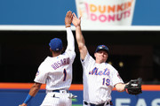 Amed Rosario #1 of the New York Mets and Jay Bruce #19 of the New York Mets celebrate a 4-1 win against the Arizona Diamondbacks during their game at Citi Field on May 20, 2018 in New York City.