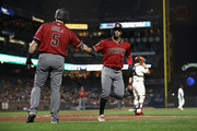Ketel Marte #4 of the Arizona Diamondbacks is congratulated by Alex Avila #5 after he scored in the fourth inning against the San Francisco Giants at AT&T Park on August 29, 2018 in San Francisco, California.