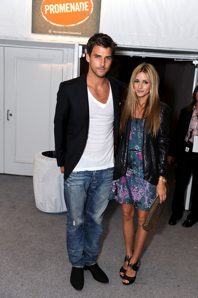Olivia Palermo Socalite Olivia Palermo (R) and Johannes Huebl attend Mercedes-Benz Fashion Week at Bryant Park on September 15, 2009 in New York, New York.