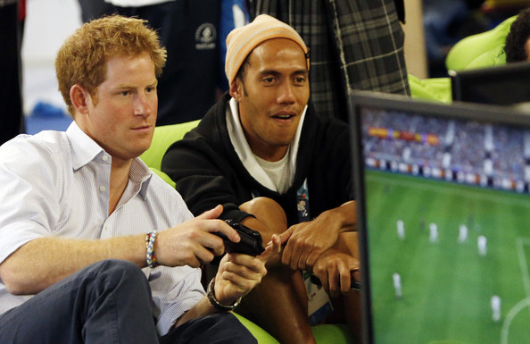 Prince Harry plays a computer game during a visit to the Commonwealth Games Village on July 29, 2014 in Glasgow, Scotland.