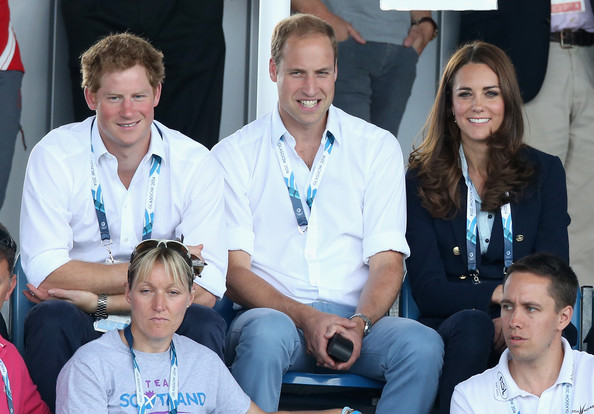 Prince Harry, Catherine, Duchess of Cambridge and Prince William, Duke of Cambridge watch Scotland Play Wales at Hockey at the Glasgow National Hockey Centre during the 20th Commonwealth games on July 28, 2014 in Glasgow, Scotland.