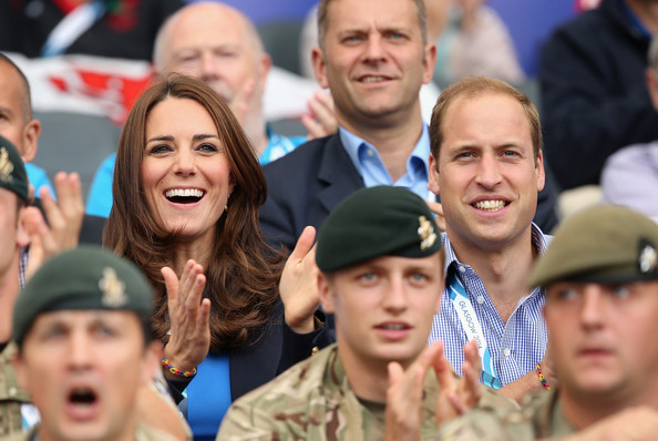 Catherine, Duchess of Cambridge and Prince William, Duke of Cambridge watch the athletics at Hampden Park as they attend the Commonwealth Games on July 29, 2014 in Glasgow, Scotland.