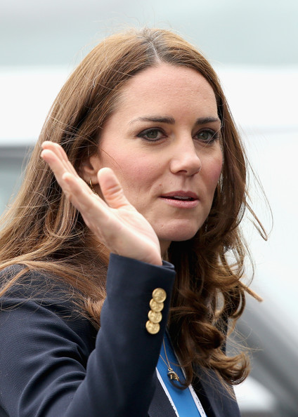 Catherine, Duchess of Cambridge waves as she leaves the athletics at Hampden Park as she attends the Commonwealth Games on July 29, 2014 in Glasgow, Scotland.