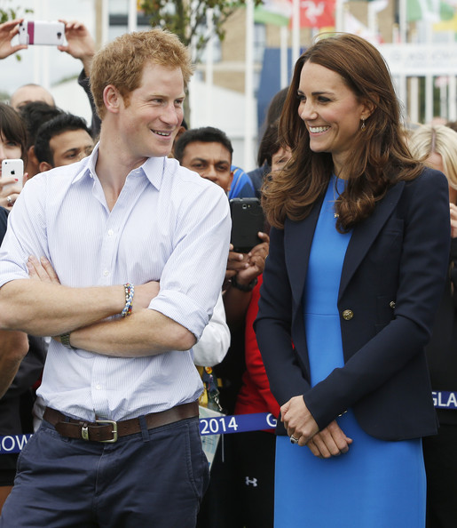 Prince Harry and Catherine, Duchess of Cambridge chat during a visit to the Commonwealth Games Village on July 29, 2014 in Glasgow, Scotland.