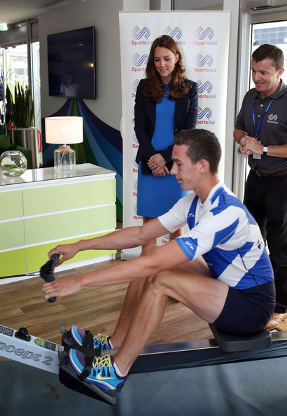 Catherine, Duchess of Cambridge watches a man on a rowing machine as she attends a SportsAid reception at 'Home Nation House' on July 29, 2014 in Glasgow, Scotland. The Duchess is patron of the charity, which funds the rising stars of British sport to help them reach the top and compete internationally.