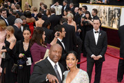 Filmmaker John Singleton (L) and guest attend the Oscars held at Hollywood & Highland Center on March 2, 2014 in Hollywood, California.