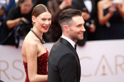 Recording artist Adam Levine (R) and model Behati Prinsloo attend the 87th Annual Academy Awards at Hollywood & Highland Center on February 22, 2015 in Hollywood, California.