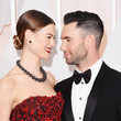 Adam Levine would not smile — even for his smiley supermodel wife.