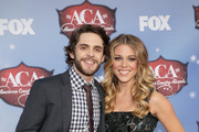 Recording artist Thomas Rhett (L) and Lauren Gregory arrive at the American Country Awards 2013 at the Mandalay Bay Events Center on December 10, 2013 in Las Vegas, Nevada.