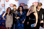 (L-R) Kelli Cashiola, recording artists Dave Haywood and Hillary Scott of Lady Antebellum, musician Chris Tyrrell, Cassie McConnell and Charles Kelley of Lady Antebellum arrive at the American Country Awards 2013 at the Mandalay Bay Events Center on December 10, 2013 in Las Vegas, Nevada.