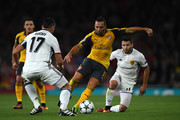 Santi Cazorla of Arsenal battles for the ball with Marek Suchy and Renato Steffen of Basel during the UEFA Champions League group A match between Arsenal FC and FC Basel 1893 at the Emirates Stadium on September 28, 2016 in London, England.