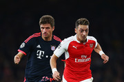 Mesut Oezil of Arsenal is chased by Thomas Mueller of Bayern Munich during the UEFA Champions League Group F match between Arsenal FC and FC Bayern Munchen at Emirates Stadium on October 20, 2015 in London, United Kingdom.