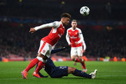 Hatem Ben Arfa of PSG (R) is fouled by Alex Oxlade-Chamberlain of Arsenal (L) during the UEFA Champions League Group A match between Arsenal FC and Paris Saint-Germain at the Emirates Stadium on November 23, 2016 in London, England.
