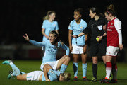 Isobel Christiansen of Manchester City goes down injured, and Jill Scott of Manchester City protests to referee Amy Fearn during the WSL Continental Cup Final between Arsenal Women and Manchester City Ladies at Adams Park on March 14, 2018 in High Wycombe, England.