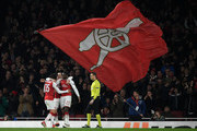 Danny Welbeck of Arsenal is congratulated by Aaron Ramsey  after scoring the third goal during the UEFA Europa League Round of 16 Second Leg match between Arsenal and AC Milan at Emirates Stadium on March 15, 2018 in London, England.