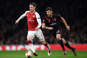 Aaron Ramsey of Arsenal breaks from Patrick Cutrone of AC Milan during the UEFA Europa League Round of 16 Second Leg match between Arsenal and AC Milan at Emirates Stadium on March 15, 2018 in London, England.